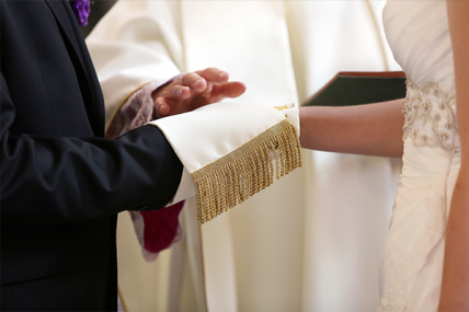 Priest-Blessing-Wedding-Couple-352658